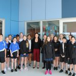 Student Leaders, Peer Supporters and House Captains standing with Ms Romagnolo outside of the Library