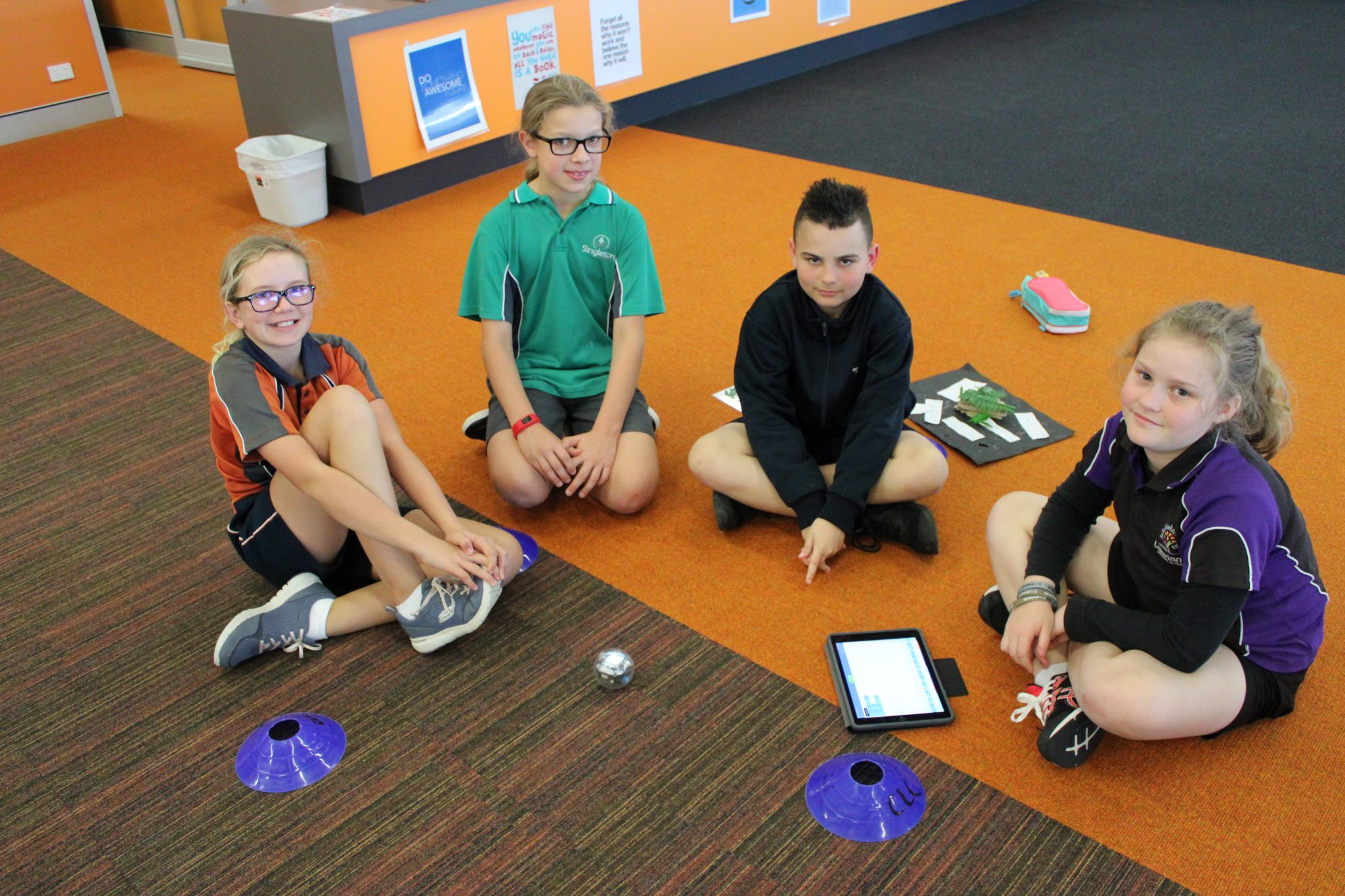 4 local primary school students playing with Spheros