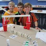 3 young boys building their reaction contraption