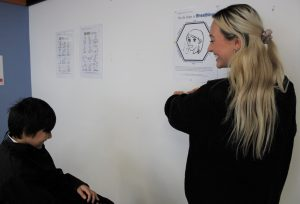 Miss Watson taking a student through a breathing exercise, one of the exercises students learn in Zones of Regulation